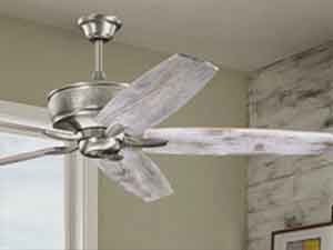 Ceiling fan with white smoked fan blades.