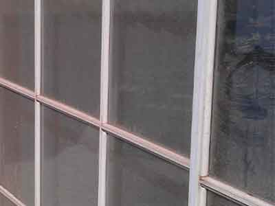 Close up view of dirty french windows with white frame.