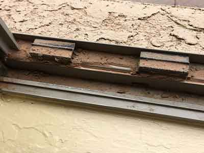 Close up view of a dirty window track.