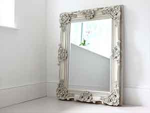 Mirror with victorian silver frame.
