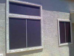 Brown sun screens installed on three windows.