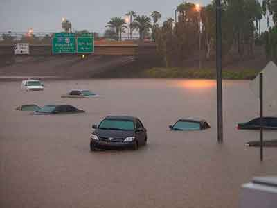 Phoenix I-10 flooded with cars submerged in the water.