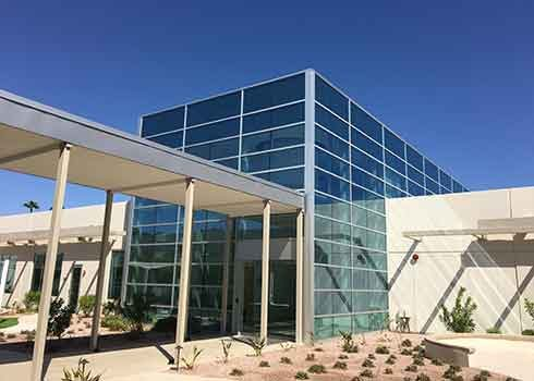 Two story commercial glass office window building in Tempe Arizona.