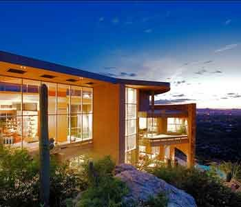 Exterior view of luxury Scottsdale home on a mountain side.